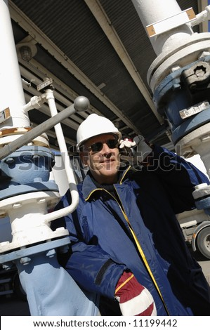 engineer, close-ups talking in phone inside oil and gas installations - stock photo