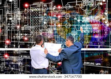 Engineer designer,electrical industrial scheme - stock photo