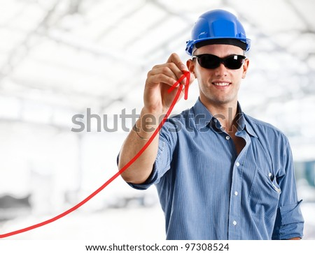 Engineer drawing a rising arrow, representing business or productivity growth
