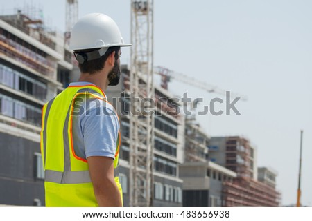 Engineer during a site walk, checking construction sequence