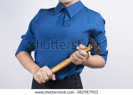 Engineer girl holding a hammer