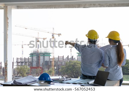 Engineer group worker meeting discussion construction stock photo engineer group and worker meeting discussion with construction blueprint on site work and point finger malvernweather Images