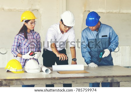 Engineer group worker meeting discussion construction stock photo engineer group and worker meeting discussion with construction blueprint on site work and point finger malvernweather Gallery