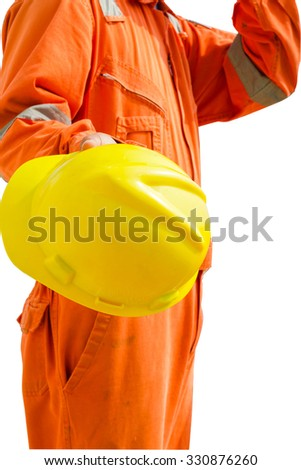 engineer hand holding yellow helmet for workers against white background. oil and gas process - stock photo