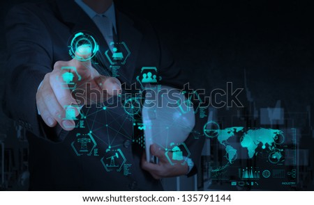engineer hand working with industry diagram on virtual computer as concept - stock photo