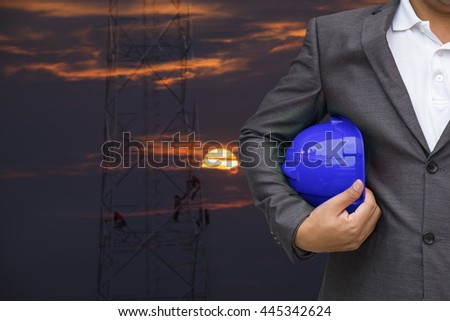 Engineer helmet for workers security over blurred construction in background - stock photo