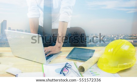 Engineer hold security helmet blueprint paper stock photo engineer hold security helmet and blueprint paper construction drawing plan near laptop computerarchitect working malvernweather Image collections