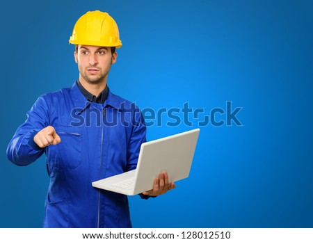 Engineer Holding Laptop Isolated On Blue Background