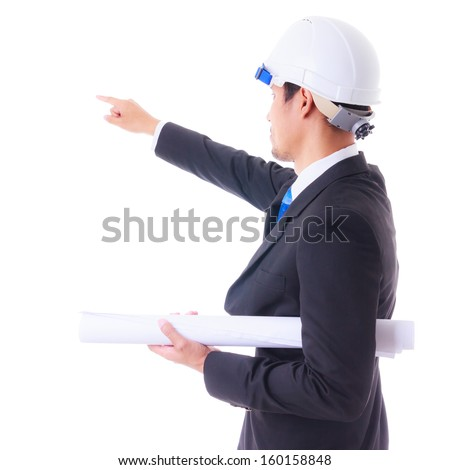 engineer holding plan and pointing to construction site isolated - stock photo