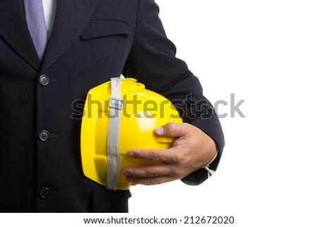 Engineer holding safety hat for going to work in the outside - stock photo