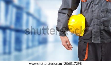 engineer holding yellow helmet for workers