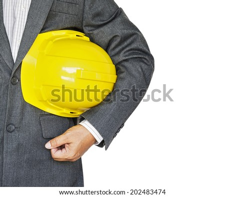 Engineer holding yellow helmet isolated on white