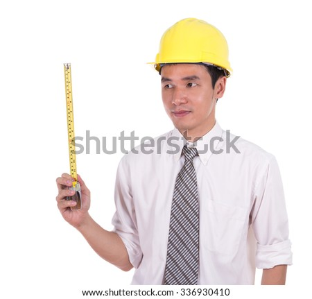 engineer in a helmet with a tape measure isolated on white background