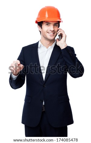 Engineer in hard hat on the phone isolated on white. Concept of successful construction