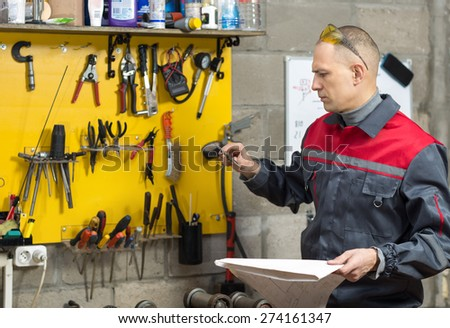Engineer in mechanical factory reading instructions