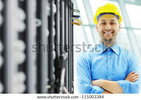Engineer in server room - stock photo