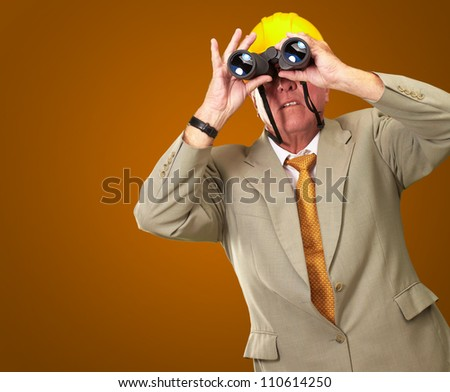 Engineer Looking Away On Red Background - stock photo
