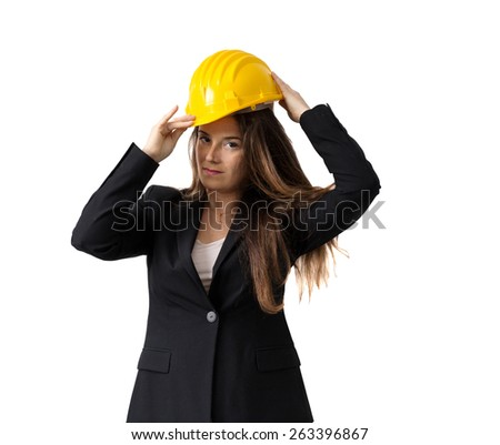 engineer makes safety gesture wearing helmet over white background