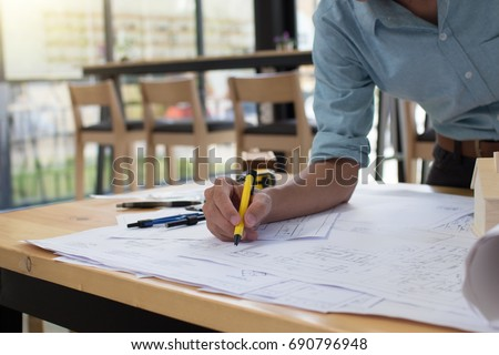 Drawing table stock images royalty free images vectors engineer man and architect drawings blueprint at construction sitehome project to offer management malvernweather Gallery