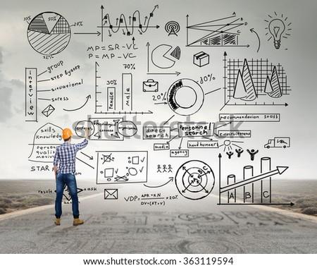 Engineer man draw ideas - stock photo