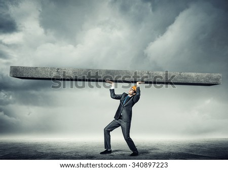 Engineer man in suit and helmet lifting wall above head