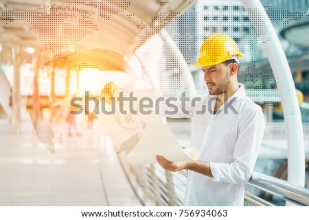 Engineer man wearing safety helmet hold stock photo 756934063 engineer man wearing safety helmet and hold blueprint document at construction site concept of project malvernweather Gallery
