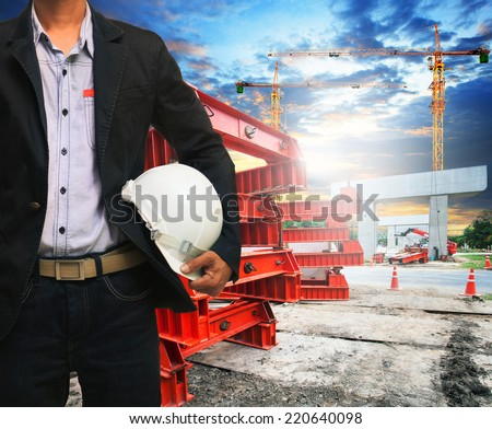 engineer man with safety helmet working in road and bridge construction site  - stock photo