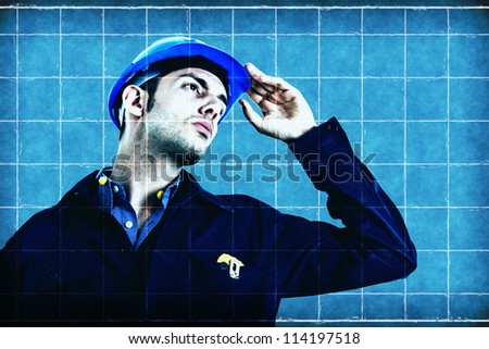 Engineer on a blueprint - stock photo