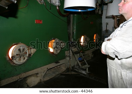 Engineer on watch in the EngineRoom - stock photo