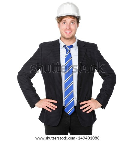 Engineer or architect business man in suit. Male businessman wearing white hard hat helmet smiling happy, proud and confident. Portrait of young male engineer in his 20s isolated on white background. - stock photo