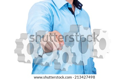Engineer pointing on gears as engineering concept - stock photo
