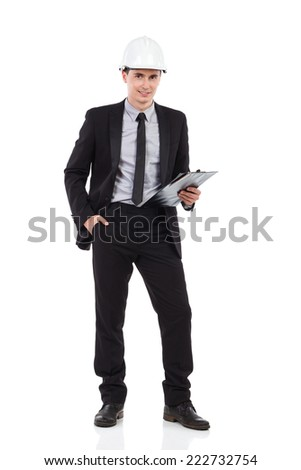 Engineer posing with a clipboard. Full length studio shot isolated on white. - stock photo