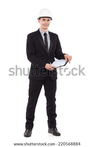 Engineer posing with clipboard. Full length studio shot isolated on white. - stock photo