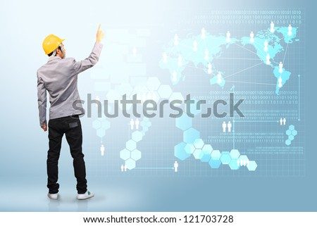 Engineer pushing on a touch screen interface - stock photo