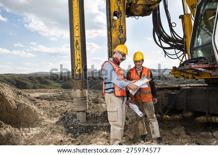 Engineer Shows Construction Worker