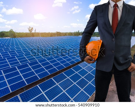 engineer stand holding yellow safety helmet front solar photovoltaic  solar power station