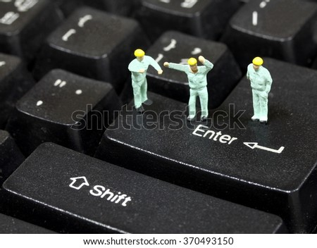 Engineer standing on the keyboard  enter. - stock photo