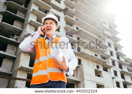 Engineer talking on the phone at the construction site
