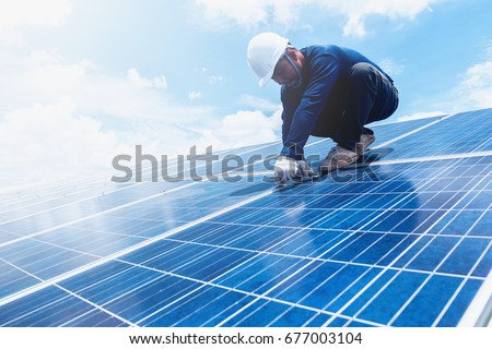 engineer team working on replacement solar panel in solar power plant;engineer and electrician team swapping and install solar panel ; electrician team checking hot spot on break panel