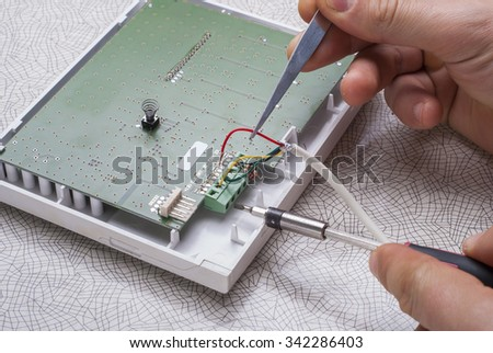 Engineer to connect the wires to the electronic control unit