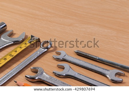 Engineer tools, wrench tools on wood table.