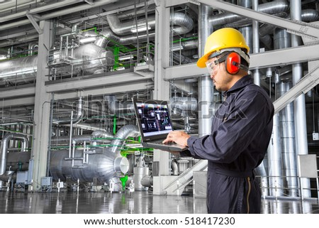 engineer using laptop computer for maintenance equipment and pipeline system in thermal power plant factory - Power Plant Engineer