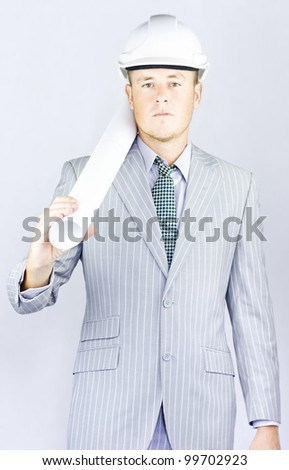 Engineer wearing a nice suit with blueprint plans on his shoulder at the job