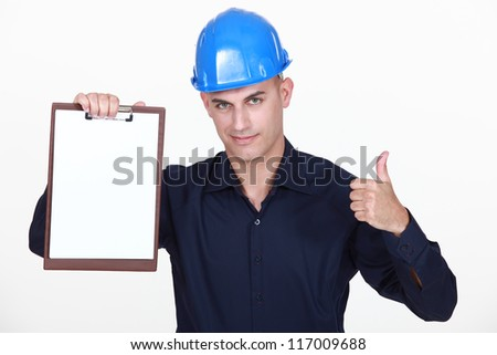 Engineer with a blank clipboard - stock photo