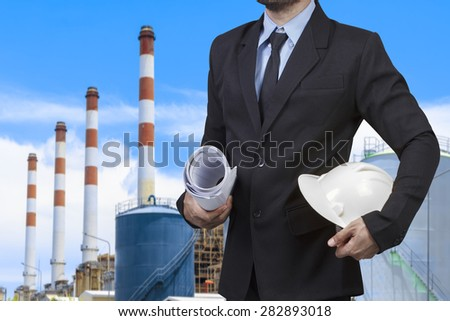 Engineer with blueprint in action at modern thermal power plants - stock photo