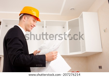 Engineer with documents in the interior of a new home or office - stock photo