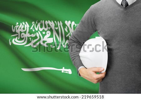 Engineer with flag on background  - Saudi Arabia - stock photo