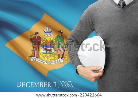 Engineer with flag on background series - Delaware - stock photo