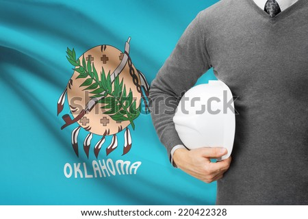 Engineer with flag on background series - Oklahoma - stock photo