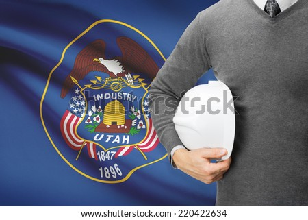 Engineer with flag on background series - Utah - stock photo